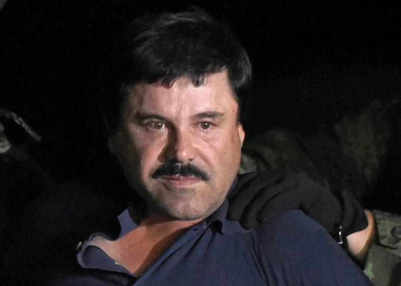 504137372-drug-kingpin-joaquin-el-chapo-guzman-is-escorted-into-a.jpg.CROP.promo-xlarge2